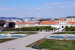 Belveder garden from palace. Vienna - fountains of Belvedere palace in morning and the town Stock Images