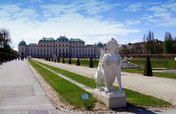 Belveder garden. Vienna - sphinx and Belvedere palace with garden by sunrise Austria Royalty Free Stock Images