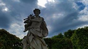 Belveder Musician. A sculpture of musician in the garden of Belveder museum.Vienna,Austria Stock Photo
