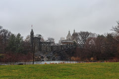 Belvedere Castle in central park. Belvedere Castle in central park, new york city during cloudy weather with skyscrapers Stock Image