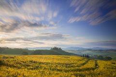 Belvedere farmhouse in San Quirico d'Orcia during sunrise Stock Images