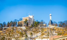 Belvedere hotel and Cetatuia in Cluj-Napoca in Transylvania region of Romania. CLUJ-NAPOCA, ROMANIA - 06 JANUARY 2015:View of Cetatuia hill with the monument and Royalty Free Stock Photography
