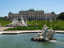 View of the gardens and  Upper Belvedere  Palace in Vienna, Austria.. Beautiful view in a sunny day of the gardens with  cascades, classical  sculptures   and Stock Images