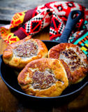Belyash ,yeast dough round pasty with meat filling . Royalty Free Stock Image