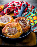 Belyash ,yeast dough round pasty with meat filling . Royalty Free Stock Photos