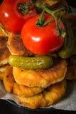 Belyashi, Tomatoes, Pickled cucumbers, Garlic, Vodka glass stock image