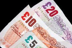 bemärker ett pund sterling Arkivbild