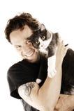 Man med hans älskade katt Arkivbilder