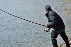 Bemannen Sie auf Fischen 13 Stockfotos