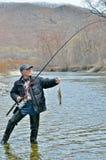 Bemannen Sie auf Fischen 7 Stockfotos