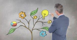 Bemannen Sie Behälter und Zeichnung von kommerziellen Grafiken auf Betriebsniederlassungen auf Wand Lizenzfreies Stockfoto