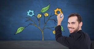 Bemannen Sie Behälter und Zeichnung von kommerziellen Grafiken auf Betriebsniederlassungen auf Wand Stockfotos