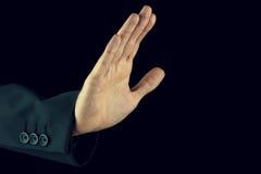 Bemannen Sie das Anheben seiner Hand in einer Endgeste Stockbilder