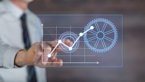 Bemannen Sie das Berühren eines digitalen Unternehmensanalysekonzeptes auf einem Touch Screen lizenzfreie stockfotografie