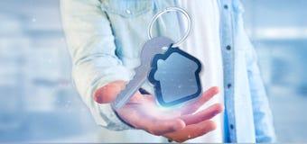 Bemannen Sie das Halten eines Schlüssels und der Wiedergabe des Hauses 3d Stockfoto