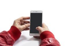 Bemannen Sie das Halten eines Weiß farbigen Telefons in seinen Händen lizenzfreie stockbilder