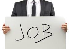 Bemannen Sie das Halten eines Zeichens mit dem Wort - Job Stockfotos