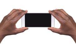 Bemannen Sie das Machen eines Fotos unter Verwendung eines intelligenten Telefons lizenzfreie stockfotos