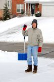 Bemannen Sie das Schaufeln des Schnees Lizenzfreie Stockfotografie
