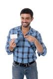 Bemannen Sie das Zeigen und das Zeigen des leeren Visitenkartelächelns glücklich Stockfotos
