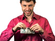 Bemannen Sie das Zerreißen von 20 Dollarbanknoten Vereinigter Staaten, die auf einem Weiß lokalisiert werden Stockfotos