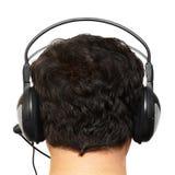 Bemannen Sie den Brunette in den Kopfhörern. Stockbild