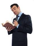 Bemannen Sie den Lehrermesswert, der das Denken des alten Buches anhält Stockfotografie