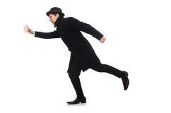 Bemannen Sie den tragenden schwarzen Mantel, der auf dem Weiß lokalisiert wird Lizenzfreie Stockfotos