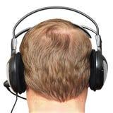 Bemannen Sie die Blondine in den Kopfhörern Stockfotografie
