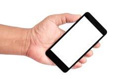 Bemannen Sie die Hand, die den schwarzen Smartphone auf einem weißen Hintergrund hält Lizenzfreie Stockfotos