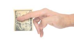Bemannen Sie die Hand, die eine Falte eine zehn-Dollar-Anmerkung klemmt Lizenzfreie Stockfotografie