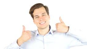 Bemannen Sie extrem glückliche gestikulierende Daumen oben gegen weißen Hintergrund lizenzfreies stockbild