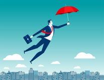 Bemannen Sie Fliegen im Himmel über der Stadt mit rotem Regenschirm in seinem ha Stockbilder