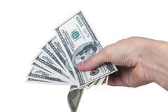 Bemannen Sie Hand mit 100 Dollarscheinen, die auf einem weißen Hintergrund lokalisiert werden Stockfotos