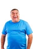 Bemannen Sie hysterisch lachen an etwas, das mit einem lustigen ex vergnügt ist Stockfotos
