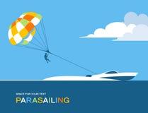 Bemannen Sie Para-Segeln mit Fallschirm hinter dem Motorboot Stockfotos