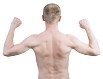 Bemannen Sie Stellung mit seiner Rückseite gegen einen weißen Hintergrund Lizenzfreie Stockfotografie