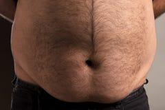 Bemannt großen Magen lizenzfreie stockbilder
