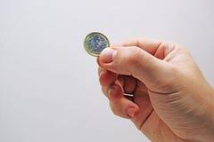 Bemannt Hand mit 1 EUR Lizenzfreie Stockfotografie