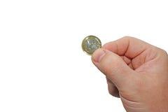 Bemannt Hand mit 1 EUR Stockfoto