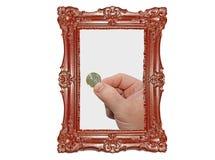 Bemant hand met 1 EUR Stock Foto's
