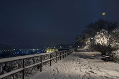 Bemch and lamp in night with snow Royalty Free Stock Photo