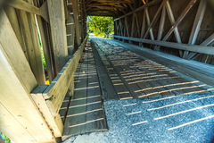 Bement Covered Bridge. The Bement Covered Bridge, a long truss bridge, is a historic wooden covered bridge on Center Road over the Warner River in Bradford, New Royalty Free Stock Photography