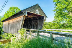 Bement Covered Bridge. The Bement Covered Bridge, a long truss bridge, is a historic wooden covered bridge on Center Road over the Warner River in Bradford, New Royalty Free Stock Photo