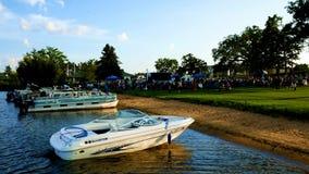 Bemidji, Minnesota - August 29, 2018: Lakeside evening concert with crowd and boats on shore. Of Lake Bemidji at Paul Bunyan Park stock video footage