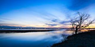 Lake Bemidji, Minnesota at Mississippi River outlet at sunset. Bemidji, Minnesota, the 2018 Best Town in Minnesota is seen across Lake Bemidji where the stock photos