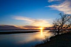Lake Bemidji, Minnesota at Mississippi River outlet at sunset. Lake Bemidji where the Mississippi River flows toward the camera at sunset on a beautiful spring stock images