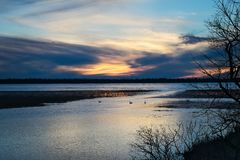 Lake Bemidji, Minnesota at Mississippi River outlet at sunset. Bemidji, Minnesota, the 2018 Best Town in Minnesota is seen across Lake Bemidji where the stock image