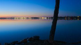 Bemidji, Minnesota across Lake Irving after sunset. Bemidji, Minnesota, the 2018 Best Town in Minnesota is seen across Lake Irving, the first lake on the royalty free stock images