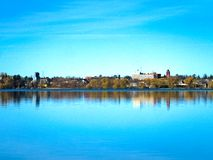 Bemidji, Minnesota reflection is seen across Lake Irving on sunny day. Bemidji, Minnesota reflection is seen across Lake Irving on calm sunny day royalty free stock photos